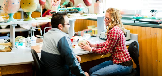A male and female student in a biology lab