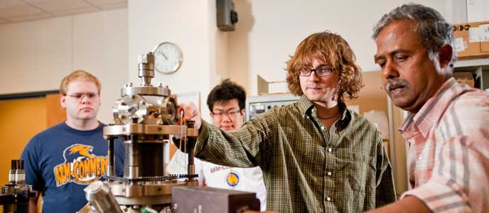 A professor demonstrating in physics lab