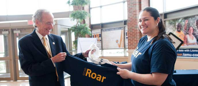 President Dan Jones with a Lion's roar t-shirt