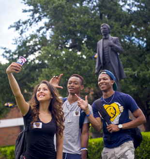 students take selfie with mayo statue